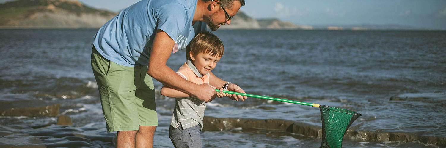 Father and son with fishing net